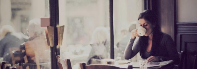 Woman drinking coffee in Caffe Nero