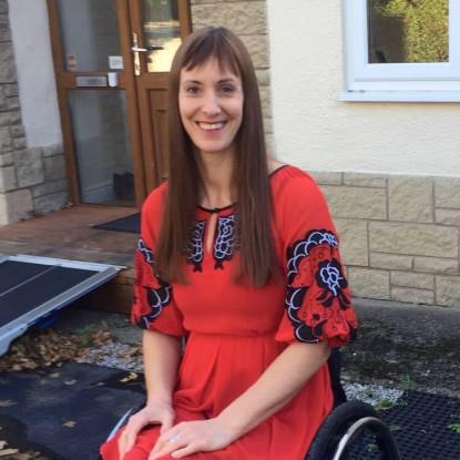 Lizzie sitting in wheelchair