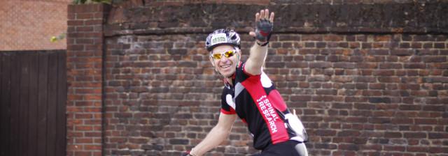 cyclist waving