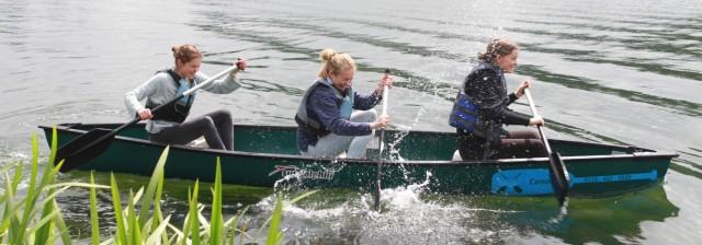 Girls rowing on a lake