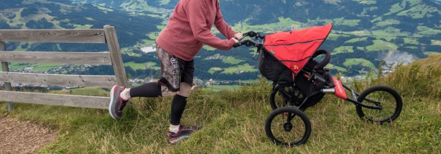 Man stepping with buggy on mountain